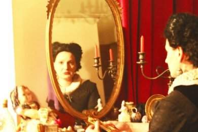 The Countess gazes in her mirror